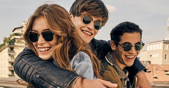Uma mulher e dois homens usando o óculos de sol Clubmaster da marcar Ray Ban
